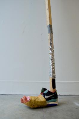 "Natalie Ball, Putter 1 2018, 2 x 2 pine, Air Max shoe, acrylic paint, sinew thread, beaded cloth, clay, beaded coin purse, spandex textile, spike tape, electrical tape,  33 "" x 11"" x 3.5"""