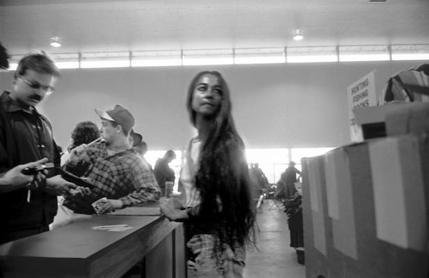 """Glenn Rudolph, """"Gun Show, Boise, ID, 1992"""", archival inkjet print, 24 x 37"""""""